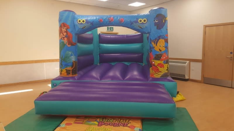 Our FAntastic under the sea themed bouncy castle featuring Baby Shark AND The Little Mermaid Available For Hire In Spalding Peterborough and Bourne